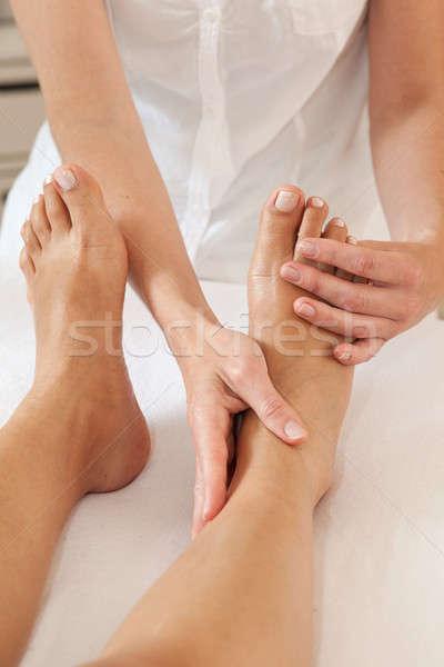 Professional feet massage Stock photo © belahoche