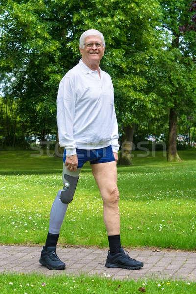 улыбаясь старший человека ложный ногу белые волосы Сток-фото © belahoche