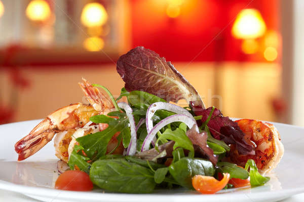 Mixed salad with fried scampi Stock photo © belahoche