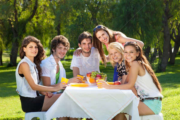 Group of college friends posing for the camera Stock photo © belahoche