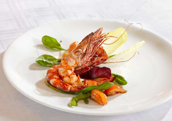 fried scampi with mixed salad leaves and cherry tomatoes Stock photo © belahoche