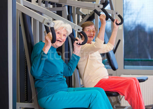Healthy Old Women Exercising at the Gym Stock photo © belahoche