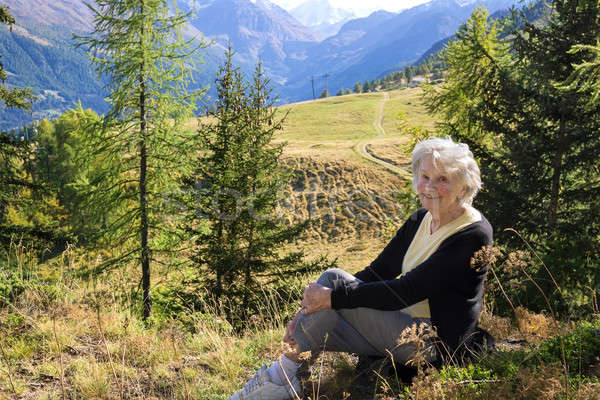 Elderly lady enjoying a vacation in the mountains. Stock photo © belahoche