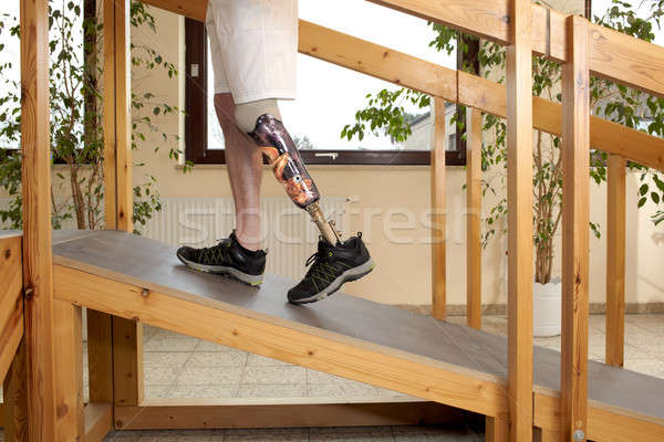 Male prosthesis wearer training to climb a slope Stock photo © belahoche