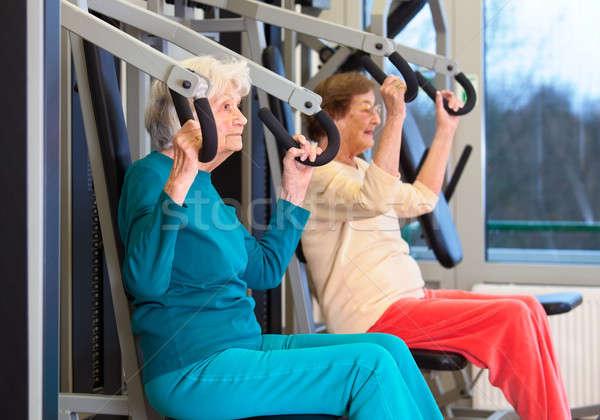 Healthy Elderly Ladies in Chest Press Exercise Stock photo © belahoche