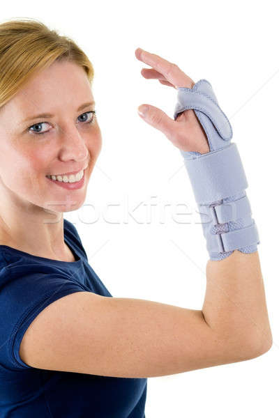 Smiling Blond Woman Wearing Supportive Wrist Brace Stock photo © belahoche