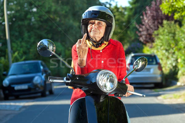 Senior woman showing the finger Stock photo © belahoche