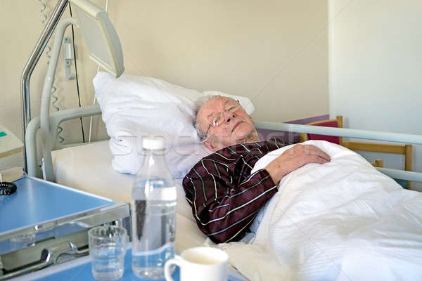 Elderly man recuperating in a hospital Stock photo © belahoche