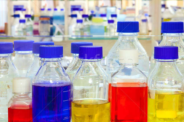 Chemical solutions in a laboratory.  Stock photo © belahoche