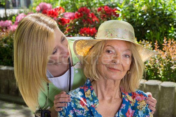 Portrait of Senior Woman with Nurse Outdoors Stock photo © belahoche