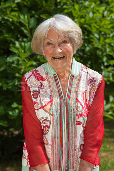 Laughing attractive female pensioner Stock photo © belahoche