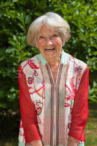 смеясь Привлекательная женщина пенсионер красный улыбаясь Сток-фото © belahoche