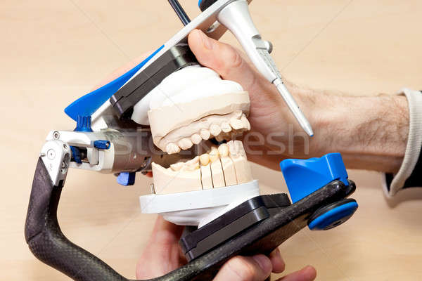 Designing Artificial Facial Dental on Device Stock photo © belahoche