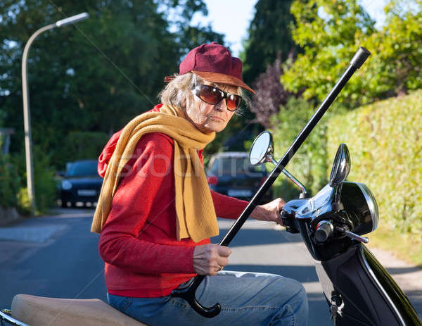 Bad tempered old woman with a walking stick Stock photo © belahoche