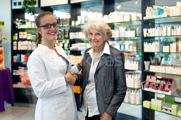 Pharmacist assisting an elderly lady Stock photo © belahoche