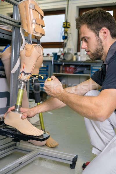 Single adult working on prosthetic leg adjustment Stock photo © belahoche
