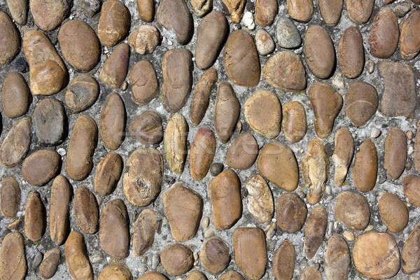 Old rounded cobblestones Stock photo © belahoche