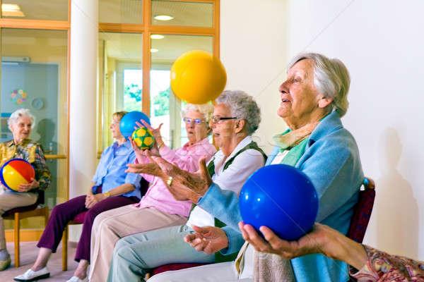 Senior ladies doing coordination exercises Stock photo © belahoche