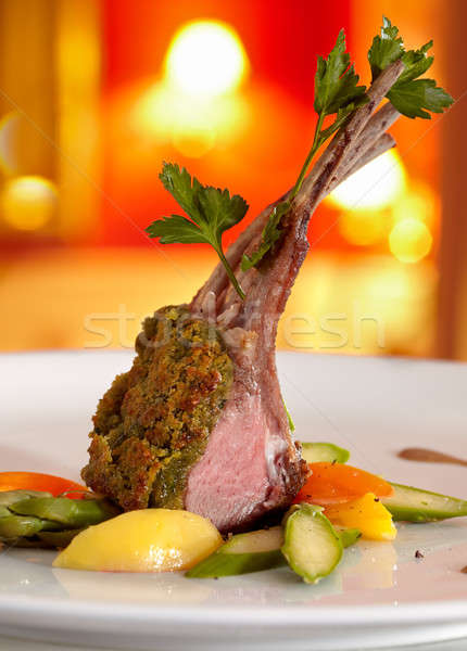 Rack of lamb in a herb crust, served with ratatouille and Portwine sauce Stock photo © belahoche