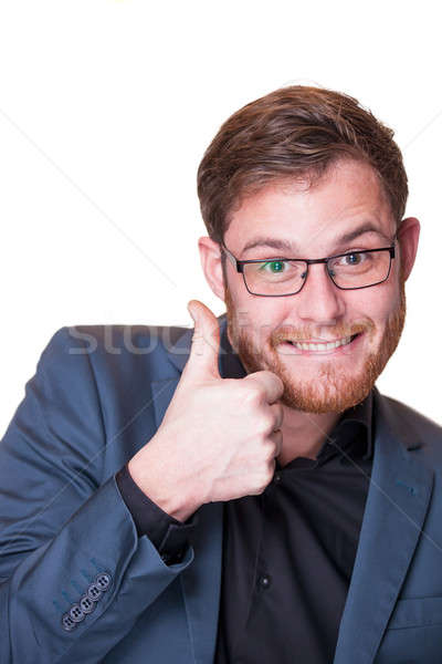 Enthusiastic man giving a thumbs up gesture Stock photo © belahoche