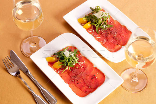 Meat Carpaccio with rocket.  Stock photo © belahoche
