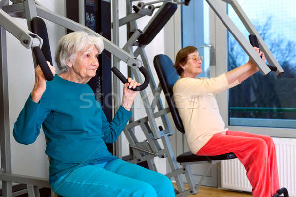 Senior Women Doing Chest Press Exercise Stock photo © belahoche