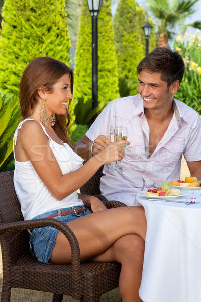 Couple in love toasting outdoors in a warm day Stock photo © belahoche