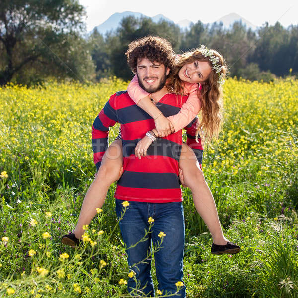 Attractive happy carefree couple in the country Stock photo © belahoche