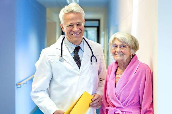 Doctor with Elderly Patient.  Stock photo © belahoche