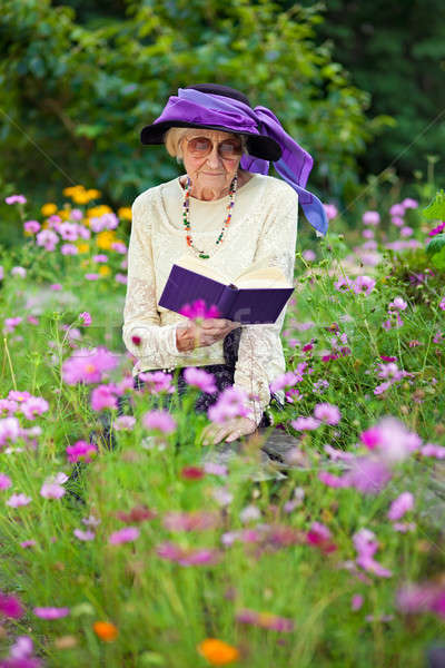 Stylish senior woman reading outdoors Stock photo © belahoche