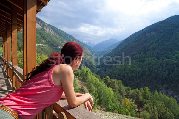 Woman Relaxing In The Alps. Stock photo © belahoche