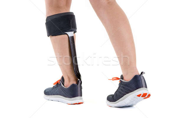 Person in Athletic Sneakers Wearing Brace on Calf Stock photo © belahoche