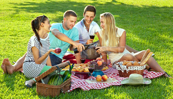 Friends enjoying a healthy picnic Stock photo © belahoche