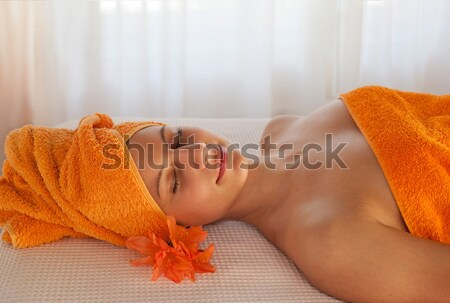 female relaxing with a massage Stock photo © belahoche