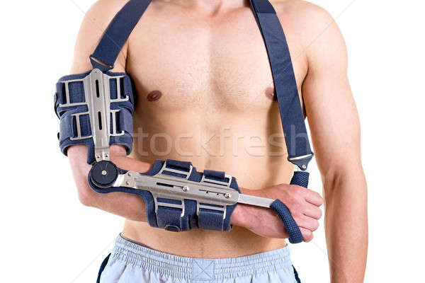 Shirtless Man with Arm in Articulated Sling Stock photo © belahoche