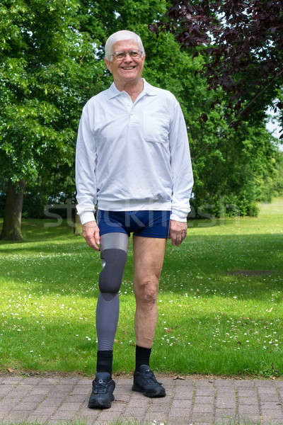 Happy senior man with false leg Stock photo © belahoche