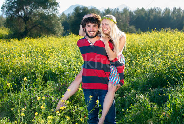 Feliz boêmio moço mulher flores cabelo Foto stock © belahoche