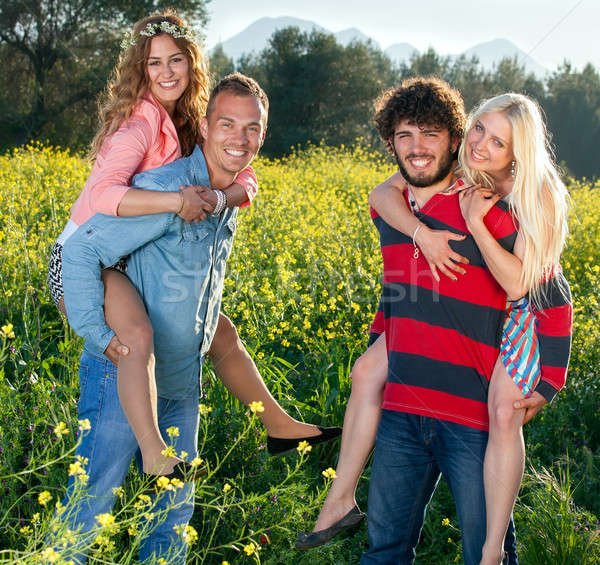 Two playful happy young couples in the country Stock photo © belahoche
