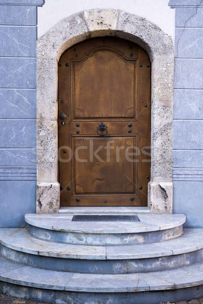 Wood Arch Door on Blue Stone Building Stock photo © belahoche