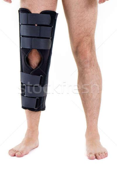 Man Wearing Leg Brace in Studio Stock photo © belahoche
