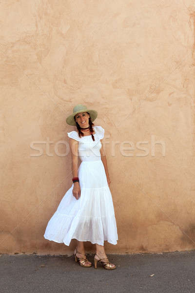 Atttractive woman in a white summer dress. Stock photo © belahoche