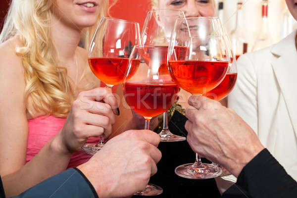 Close up Tossing Glasses of Red Wine Stock photo © belahoche