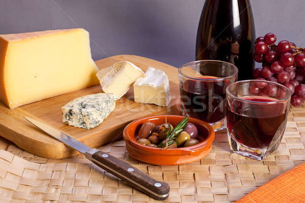 Glasses of red wine and mediterranean appetizers. Stock photo © belahoche