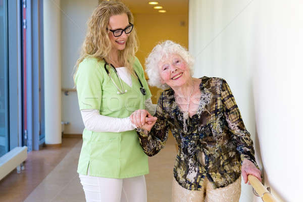 Medical Assistant Assisting Happy Elderly Patient Stock photo © belahoche