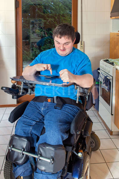 Spastic young man confined to a wheelchair Stock photo © belahoche