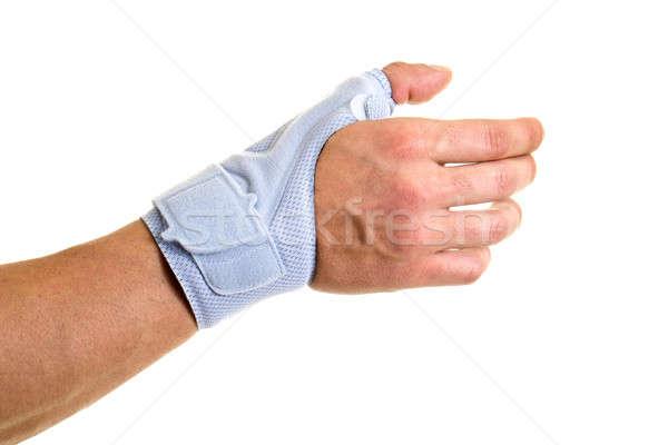Férfi visel támogató csukló kéz közelkép Stock fotó © belahoche