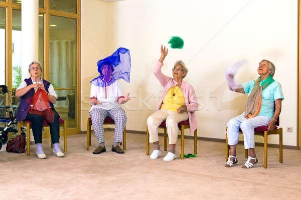 Senior ladies having fun while exercising Stock photo © belahoche