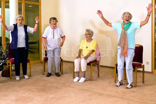 Idős nők áll ül testmozgás csoport Stock fotó © belahoche