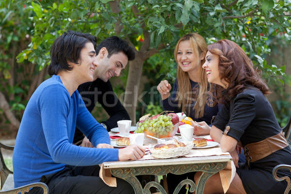 Young Friends Enjoying Coffee At A Restaurant Stock photo © belahoche