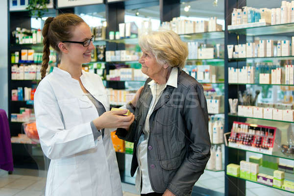 Pharmacist and grateful senior woman Stock photo © belahoche